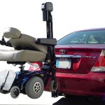 TRILIFT Classic on a class II Receiver Hitch, carrying a Pride Select on a Toyota Camry.