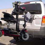 TRILIFT Ultra Lite carrying a Pride gogo on a Ford Explorer.